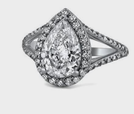 http://www.brilliantearth.com/custom-rings/Petite-Split-Shank-Halo-Ring-284/