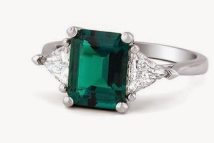 http://www.brilliantearth.com/custom-rings/Emerald-and-Trillion-Cut-Diamond-Ring-299/